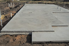 Concrete slab. Prepared for residential house construction with utility pipes within slab royalty free stock photography
