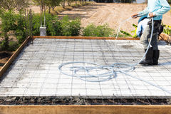 Concrete slabs  construction. Construction workers work on a hose with water before pouring concrete slabs Royalty Free Stock Photos