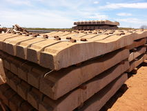 Concrete  sleepers in a stack for train rail line construction Royalty Free Stock Photo