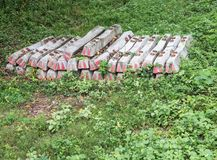 Concrete sleepers pile on the ground. Stock Photos