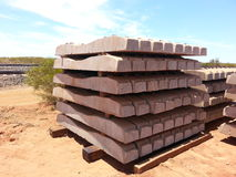 Concrete  sleepers in a stack for train rail line construction. Concrete sleepers neatly stacked for construction of a railway line Stock Image