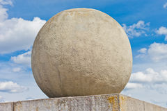Concrete sphere against a sky background Stock Photos