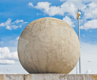 Concrete sphere against a sky background Royalty Free Stock Photos