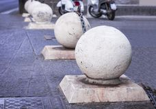 Concrete spheres prohibiting parking barrier on the street in Catania, Sicily, Italy royalty free stock image