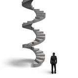 Concrete spiral staircase with man looking up Stock Photo