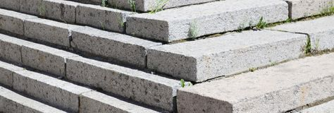 Concrete staircase at the entrance to the building. Stairs going up diagonally. Stair concrete staircase at the entrance to the building. Concrete stairs going stock image
