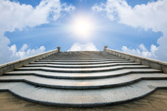 Concrete staircase going up into a blue sky Royalty Free Stock Image