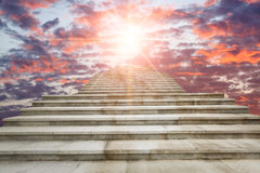 Concrete staircase going up into sunrise clouds sky Royalty Free Stock Image