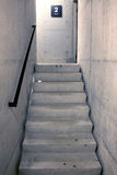 Concrete staircase and stairs leading upwards to second floor Stock Images