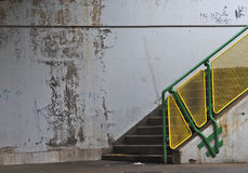 Concrete staircase with yellow-green railing Stock Photography