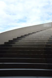 Concrete stairs. Against blue sky with dramatic light Stock Photos