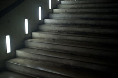 Concrete stairs in a building. Concrete stairs with little side windows in a modern building Stock Photography