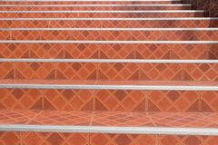Concrete stairs are decorated with the brown grid tile. On top and steel cover on the corner, Dirty stairs stock images