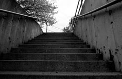 Concrete Stairs. Grungy concrete steps with handrails Royalty Free Stock Image