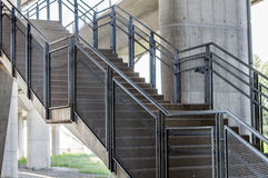 Concrete stairs are metal handrails. Close Royalty Free Stock Images