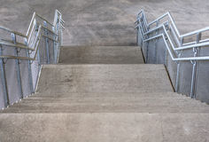 Concrete stairs and metal handrails under the bridge Royalty Free Stock Photography