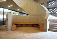 Concrete stairs in modern building. Architectural detail with concrete stairs and wooden sitting area in New Tate Gallery Royalty Free Stock Images
