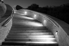 Concrete Stairs at Night. This picture is a night shot of concrete stairs while lights illuminate the direction to follow royalty free stock image