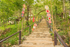 Concrete stairs to the sacred place on the mountian with decorations on the gate Stock Photos
