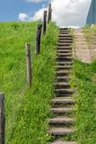 Concrete stairs to the top of a dike. Concrete stairway to the top of a Dutch dike on a sunny day in the spring season. In addition to the staircase is a fence Royalty Free Stock Photos