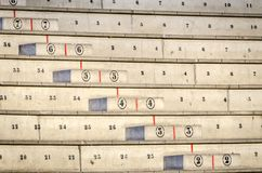 Concrete stands or bleachers. Numbered concrete stands or bleachers distributed in rows and columns for audience or spectators royalty free stock photo
