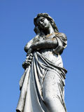 Concrete statue. Beautiful concrete statue against the blue sky Royalty Free Stock Photo