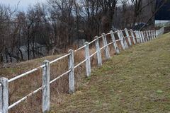 Concrete & steel fence needing repair Royalty Free Stock Photos