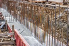 Concrete steel reinforcement in foundation of a new building Stock Photography