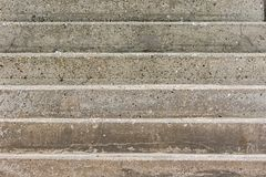 Concrete steps. Abstract close-up. Conceptual image of a hard climb. Concrete steps. Abstract close-up of a hard man-made climb to the top. Conceptual background stock photo