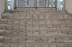 CONCRETE STEPS. Leading up to locked metal gate Royalty Free Stock Photo