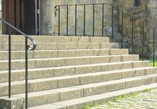 Concrete steps and railings. A set of concrete steps and railings leading into a door Royalty Free Stock Photography