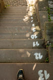 Concrete steps with step numbers. Remaining to reach the bottom Stock Photography