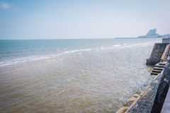 The concrete stone barrier that prevent waves of sea at Pranburi. stock photo
