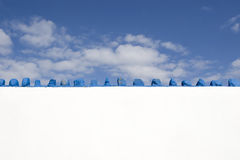 Concrete stone white wall against blue sky Royalty Free Stock Images