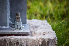 Concrete support and metal construction is bolted together. Is close royalty free stock images