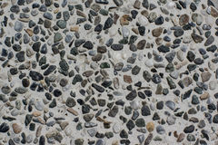 Concrete Surface Embedded With Gravels. Concrete Surface Embedded With Gravels of Black, Gray, And Rusty Colors Royalty Free Stock Photo