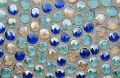 Concrete surface with glass balls Royalty Free Stock Photos