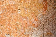 Concrete surface with the remains of orange paint and whitewash Royalty Free Stock Photos