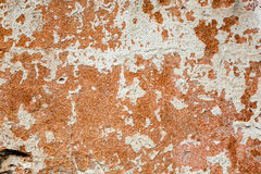 Concrete surface with the remains of whitewash and orange paint Royalty Free Stock Photography