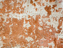 Concrete surface with the remains of whitewash and orange paint Stock Images