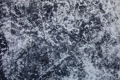 Concrete surface stained with whitewash and coal tar. Stock Photo