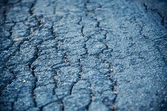 A concrete surface of a street with cracks. Beautiful hard concrete surface with cracks of a traditional street unique photo stock images