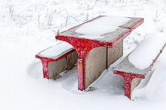Concrete table and chairs in snow Stock Photo