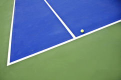 Concrete tennis. Court image and ball Royalty Free Stock Photo