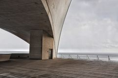 Concrete terrace with misterious industrial Atlantic Ocean view. In Santa Cruz of Tenerife. Minimalistic architecture. Cold colors Stock Images