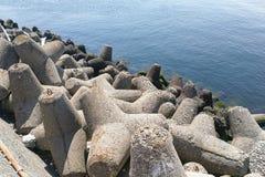 Concrete tetrapod at coast line to prevent erosion and protectio Stock Photos