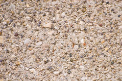 Concrete texture. A background texture of concrete, sand and small rocks Stock Images