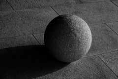 Concrete textured sphere in sunlight Stock Images