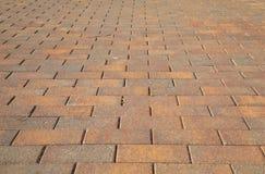 Concrete tile for garden paths. perspective view. Concrete tile for garden paths in warm colors. perspective view Royalty Free Stock Photos