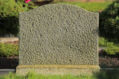 Concrete tombstone with sunlight from the right side Royalty Free Stock Image